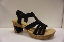 """Rieker-sandal, svart med beige """"kork""""-sula, resår över foten, klack: 7 cm, sulan 1,5 cm."""